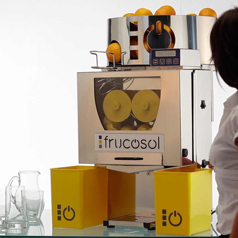 Frucosol F-50AC Automatic Juicer In-Use