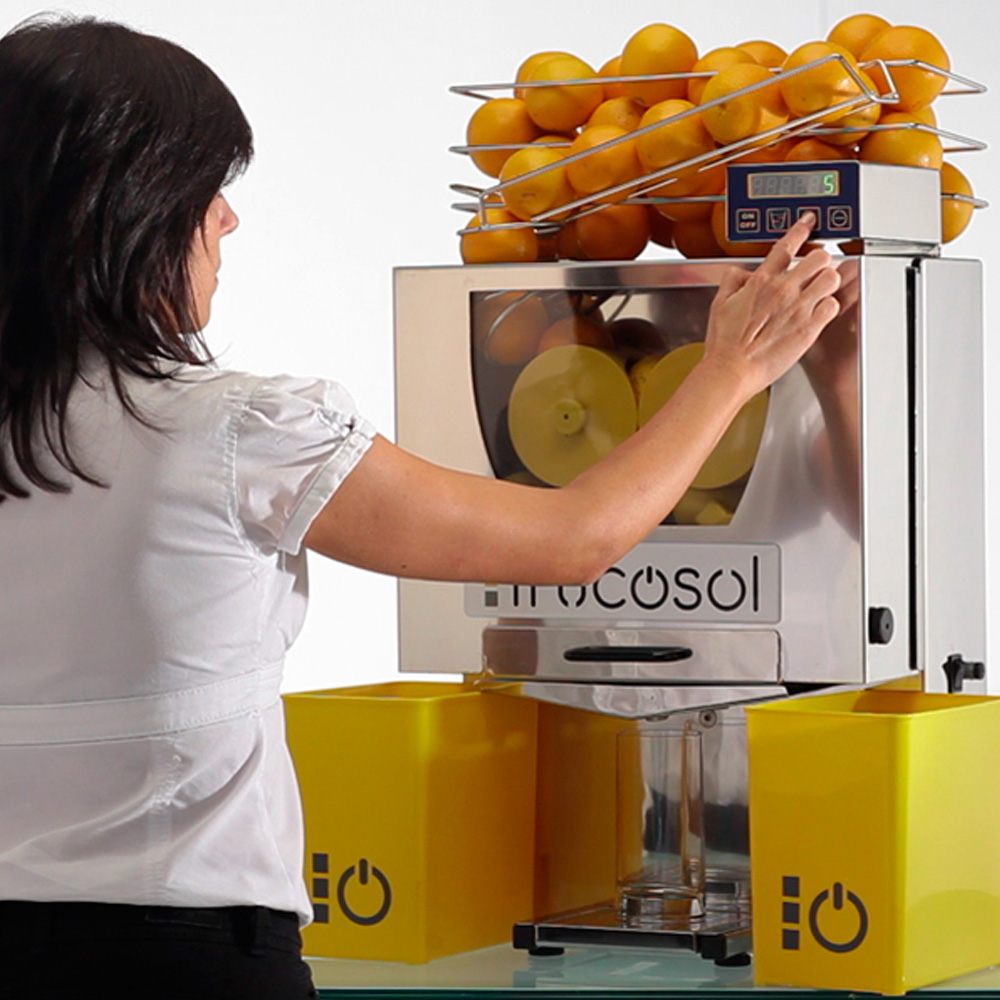 Frucosol F-50C Automatic Juicerr-in-use